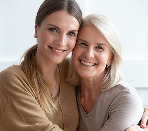 Close up image aged mother adult daughte
