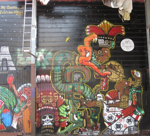 A Mural of the Lady Xoc Maya glyph with graffiti in San Francisco's Mission District
