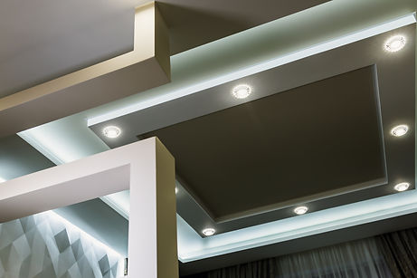 modern interior room with tiered ceiling