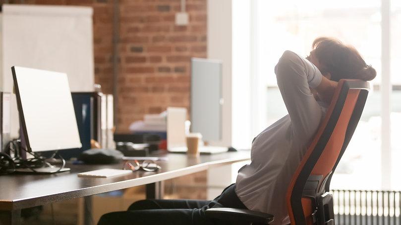 Calm businesswoman office worker holding