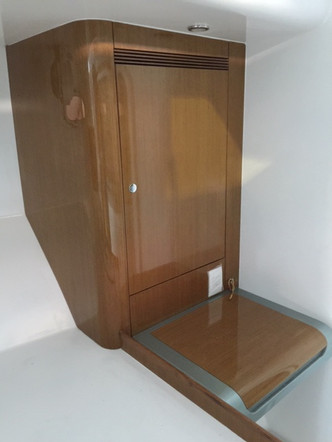 Teak veneer and solids so light that you can pick the whole cabinet up with one hand!