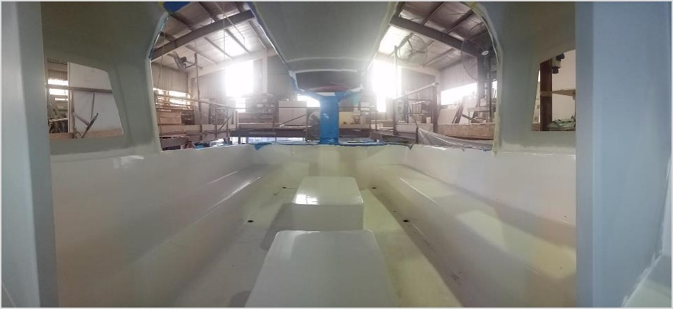 Facing the rear of the Rapido 60 Racer / Charter boat seen here, pictured in Triac Composites' factory in HCMC.
