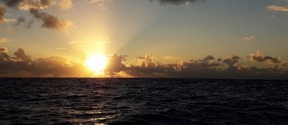 A setting sun aboard Ineffable mid Atlantic Ocean, December 2018.