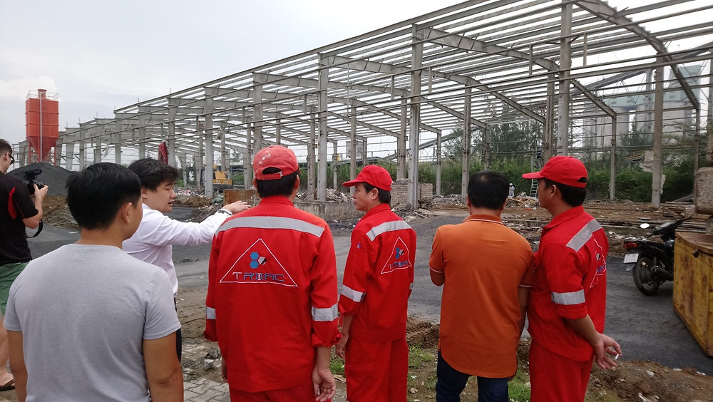 UniDepot's CEO, Mr Minh, speaks to Triac Composites' staff about the new factory.