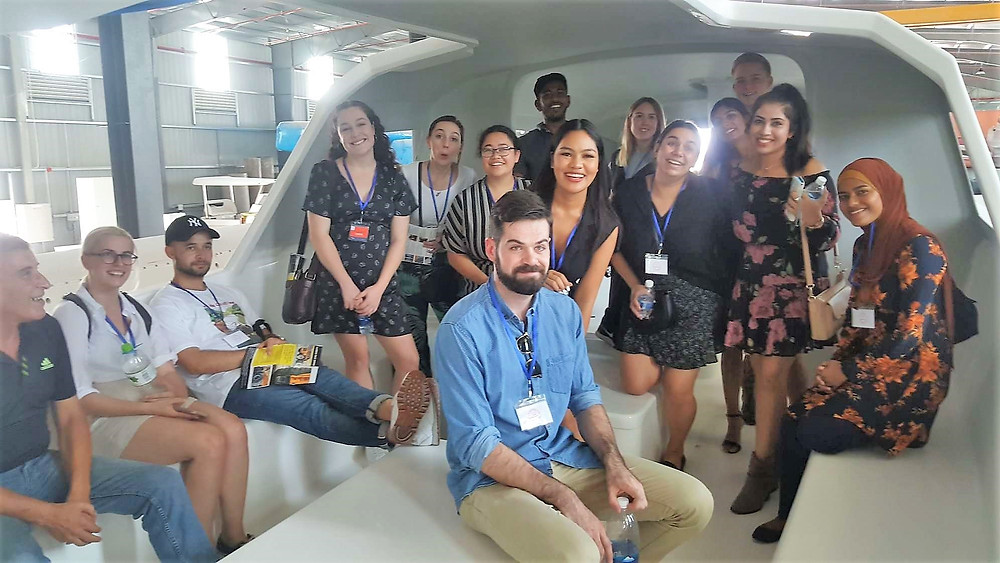 The International Business students from QUT find out for themselves just how big a 60' Rapido Trimaran is when visiting Triac Composites' factory in HCMC, Vietnam.