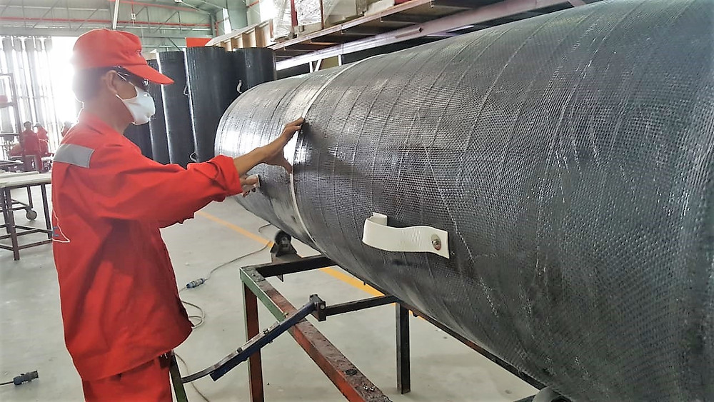 Adding the finishing touches to the carbon fiber ventilation tubes. The tubes are manufactured by Triac Composites.