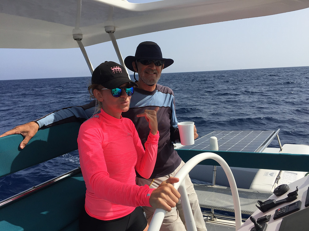 Steph, new crew member of Ineffable, is the steady helm at 20.5 knots!! Pictured with Richard Eyre, co founder of Rapido Trimarans.