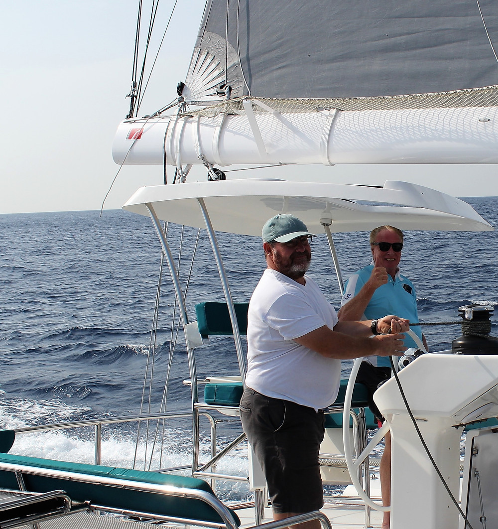 """Steve Bourne (right) is the """"over the moon"""" new owner of R60 """"Ineffable"""" in Las Palmas, Gran Canaria. Pictured with Steve is crewman, Mark Haswell as they travel at 16 knots up wind, preparing to sail the Atlantic!"""