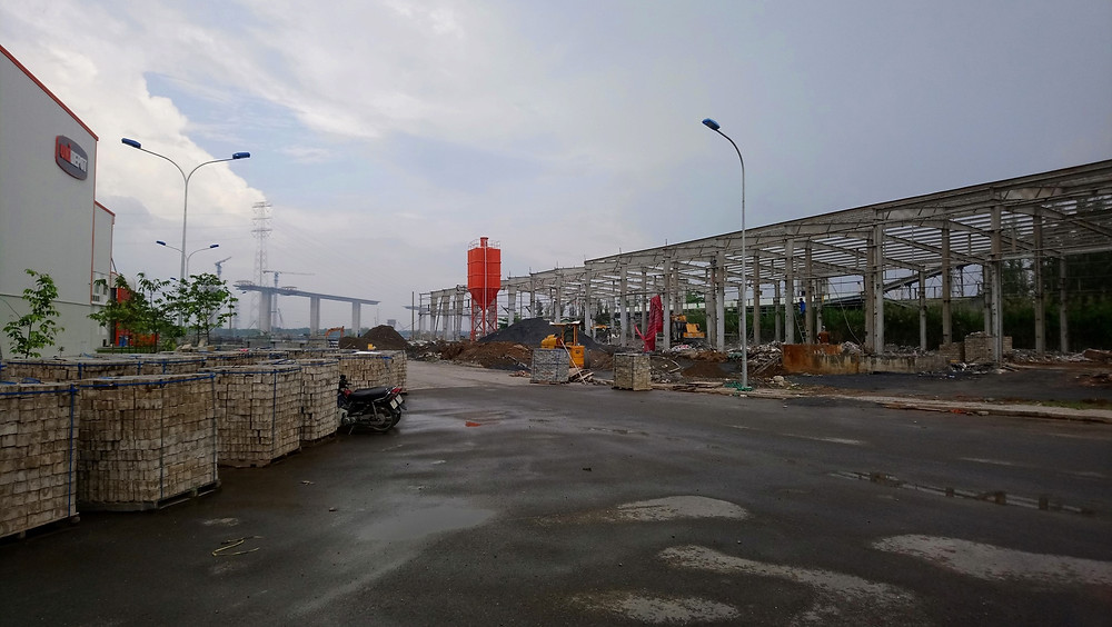 The Triac Composites factory on the right is being totally refurbished to the same standard as the warehouse on the left. In the background is the new bridge for the Ben Luc- Long Thanh Freeway which is currently under construction. And it's all within 30 minutes of the centre of HCMC, Vietnam.