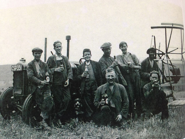 Old family photograph of farm workers