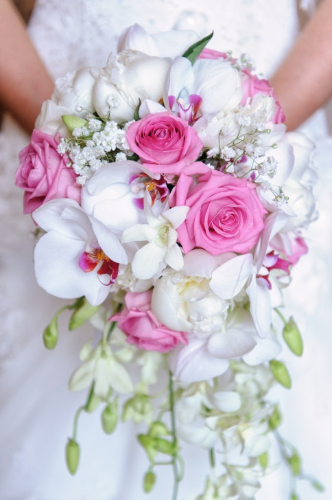 Pink roses and white orchid bridal bouquet