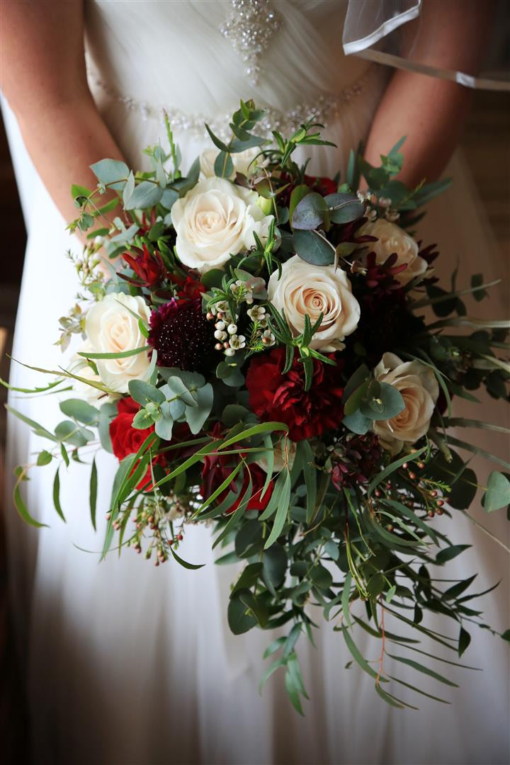 A beautiful cascade handtie of burgundy blooms and champagne roses with gorgeous foliage  A lovely handtied bouquet of burgundy germini, white roses, succulents and beautiful eucalyptus and red berries  A white and grey bouquet of white rose, white ranunculus, thistle with selection of beautiful seasonal winter foliage.