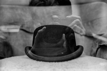 Hat through a window.