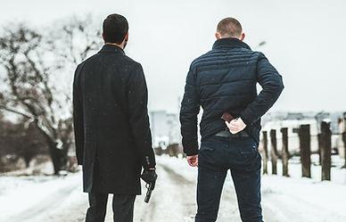 Männer mit Gewehren