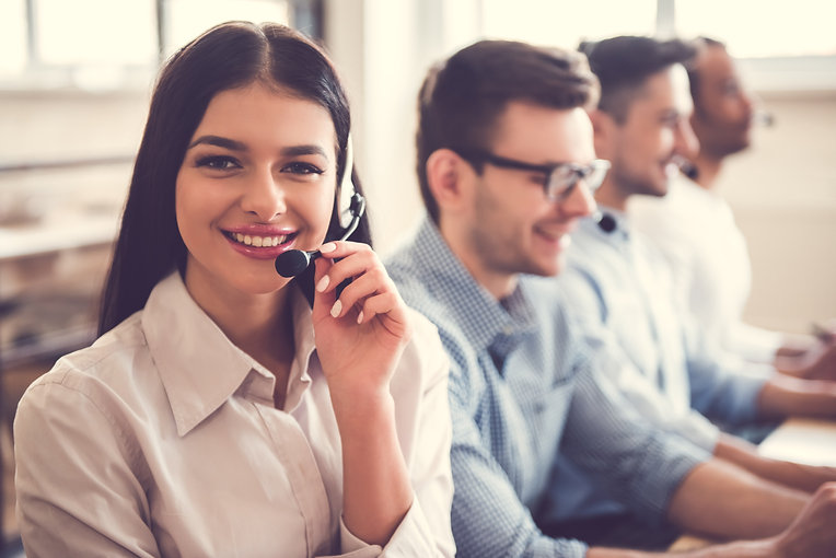 Beautiful business people in headsets ar