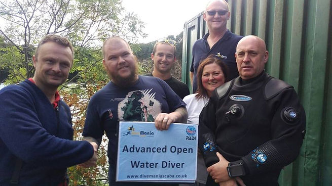 The DiveMania Team congulating an Advanced Diver