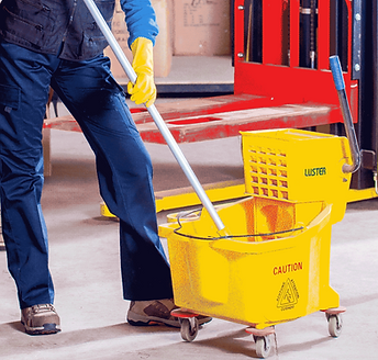 A person holding a mop stick inside a yellow bucket