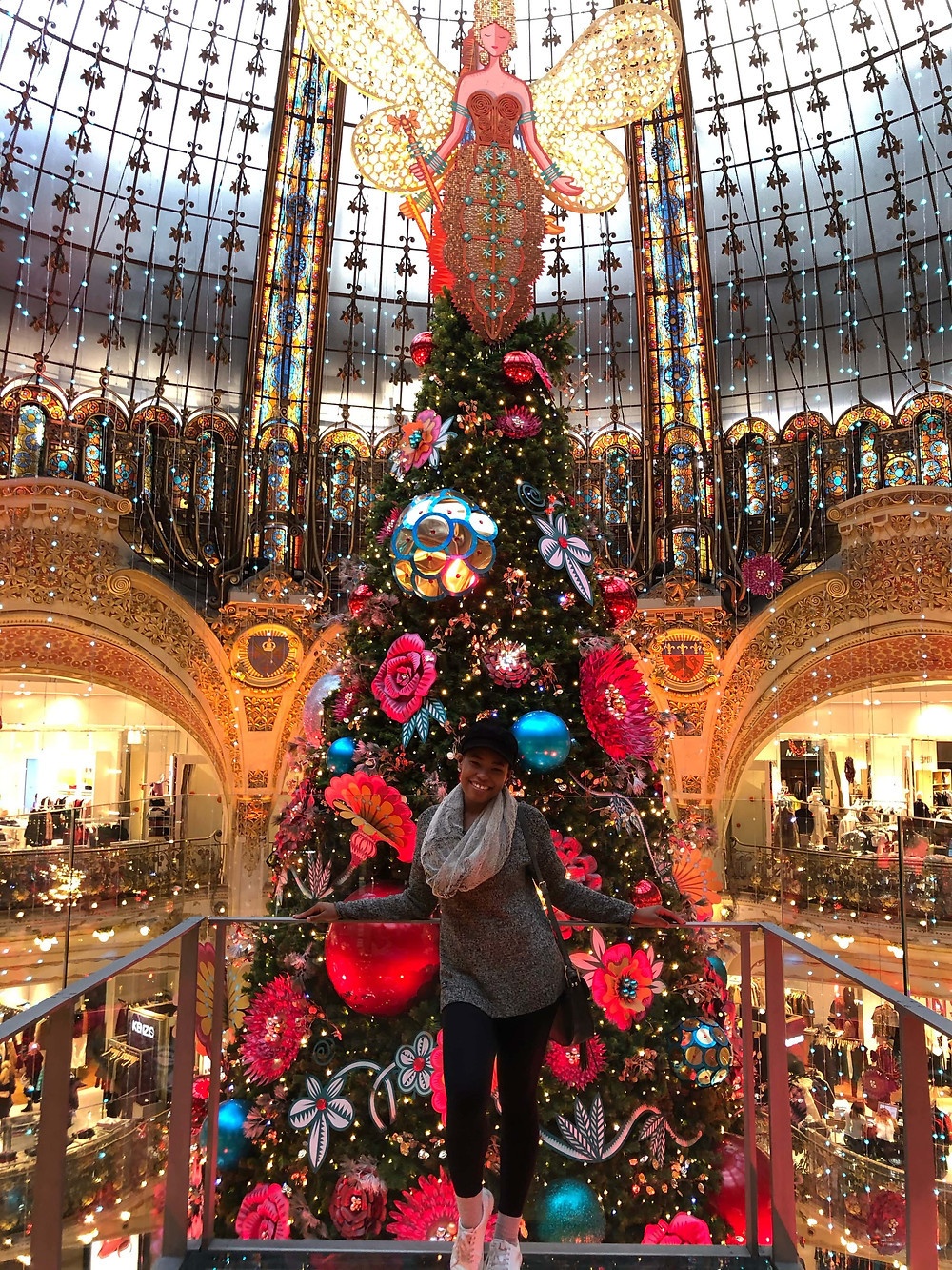 Posing in front Galleries Lafayette Christmas tree