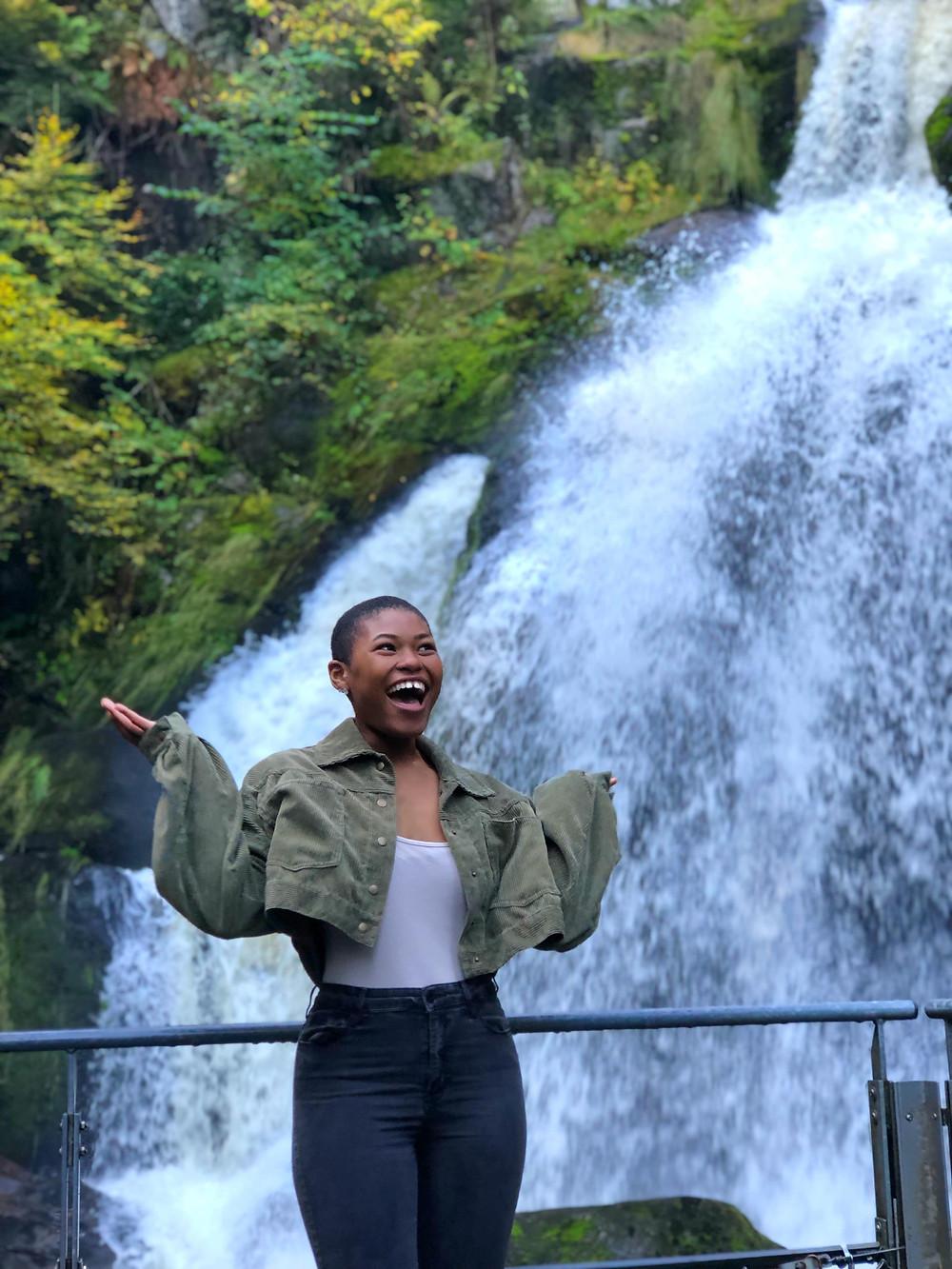 posing by waterfall in Germany