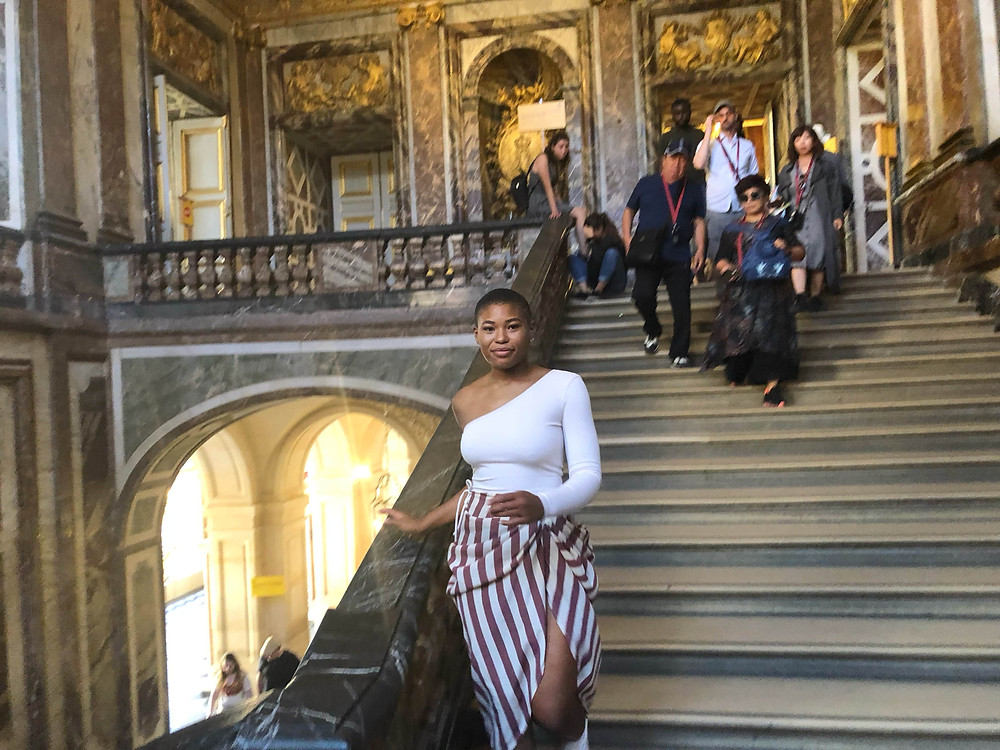 walking down stairs in Palace of Versailles