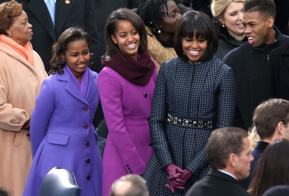 Sasha and Malia Obama in purple coats