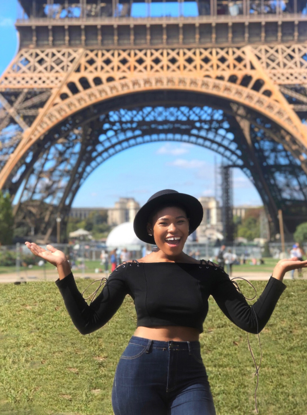arms up in front Eiffel Tower