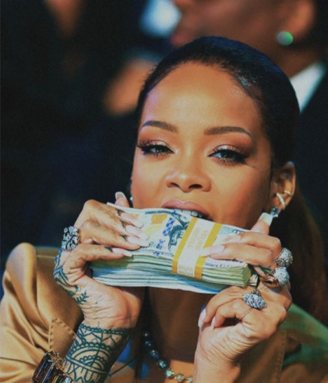 Rihanna biting money