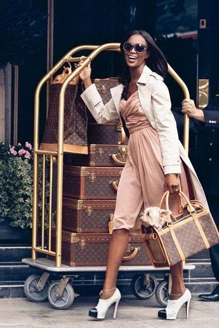 Naomi Campbell with lots of luggage