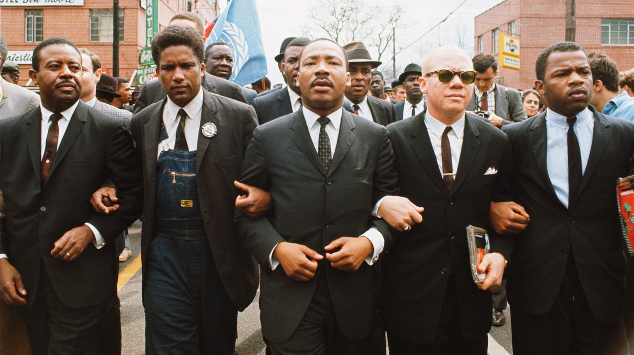 John Lewis marching with Dr. Martin Luther King Jr.