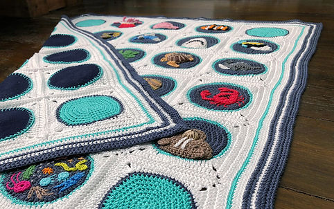Crochet A-B-Sea blanket folded on floor
