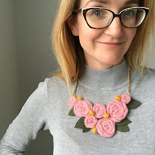 Pony McTate wearing yarn necklace