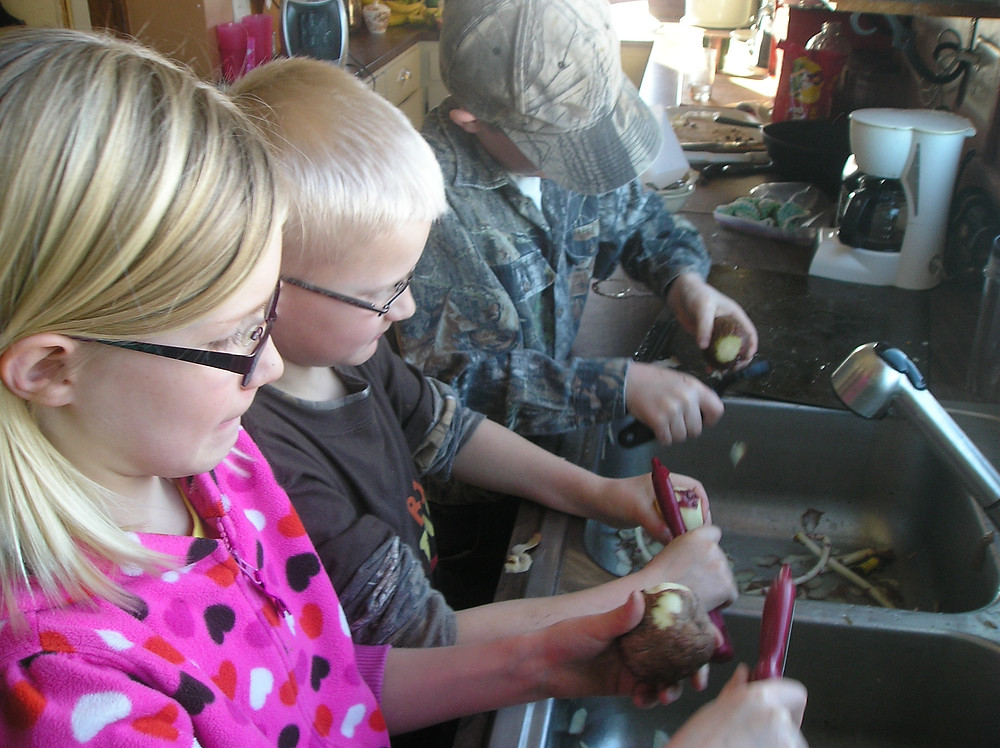 kids peeling potatoes, Apple Prairie Farm