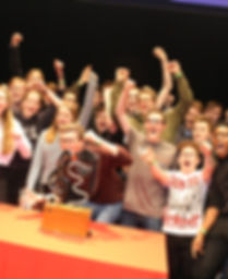 Photo of band celebrating their win at a UniBrass contest hosted at University of York