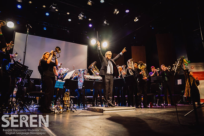 Brass band performance finale with conductor facing audience