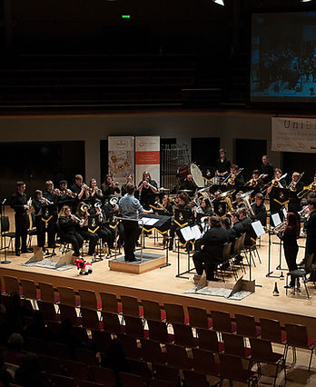 Photo of Bangor University Brass Band performing at a UniBrass contest hosted at Warwick University