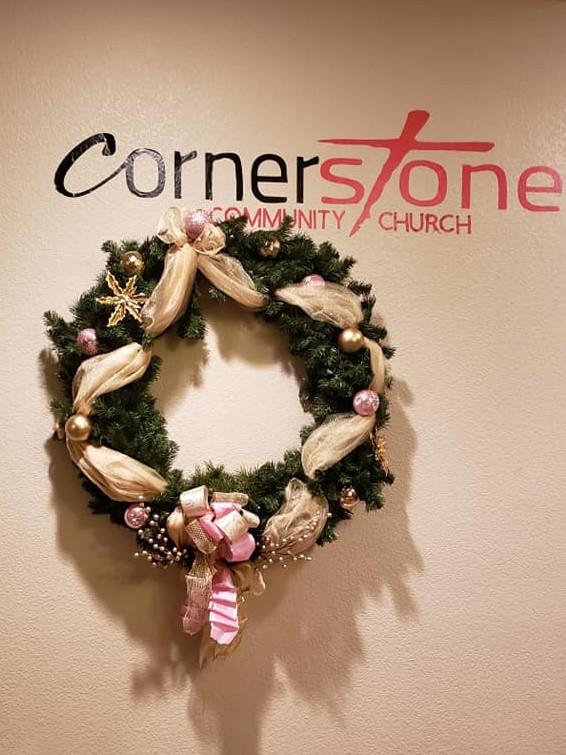 Christmas wreath under Cornerstone Commu
