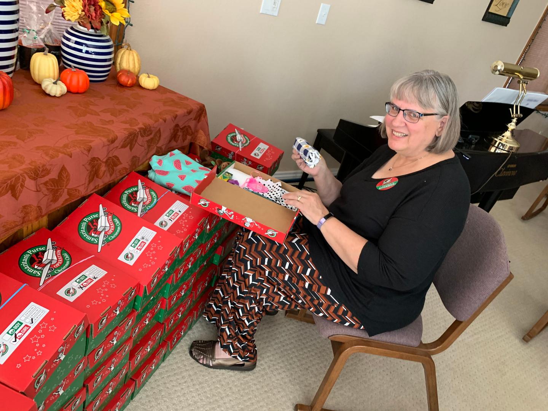 Lynda with OCC shoeboxes.jpg