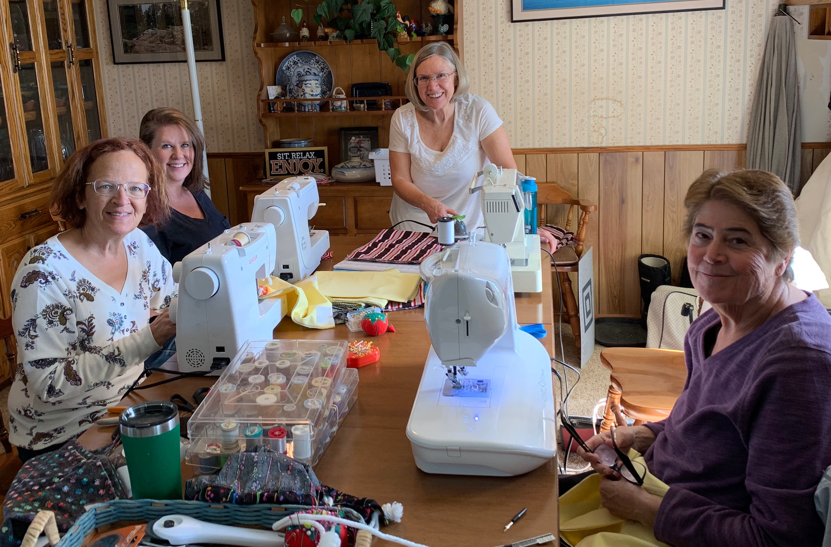 OCC ladies sewing gifts for shoeboxes.jp