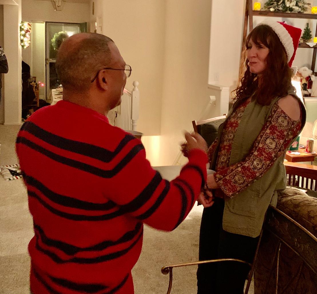 Ray and Shawna talking at 2019 Christmas