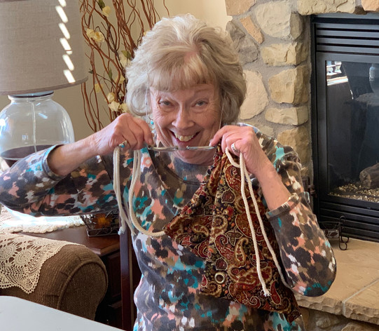 Carol stringing backpacks - OCC creation