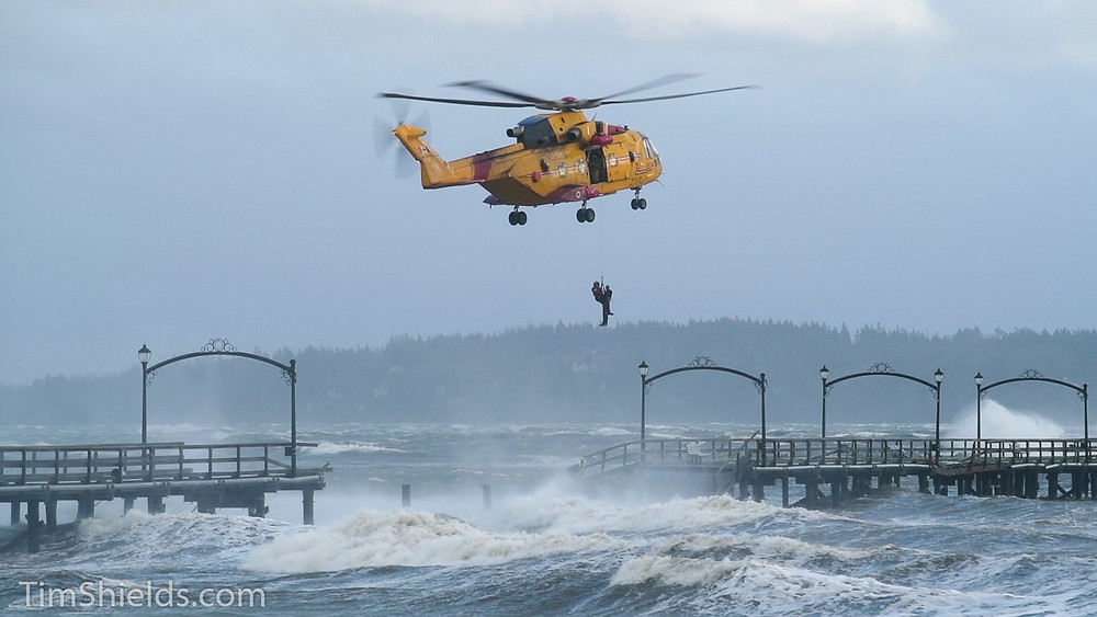 man lifted by helicopter in white rock