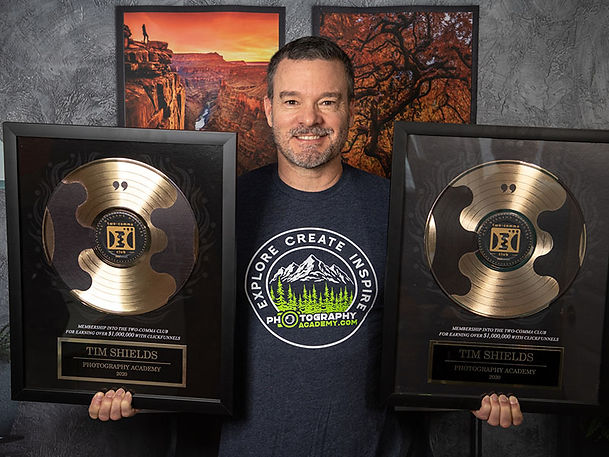 Tim Shields holding business awards from Clickfunnels