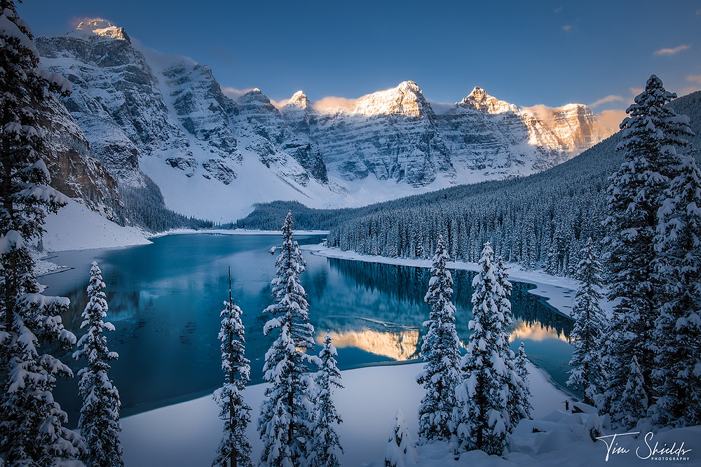 Moraine Lake covered by early season snow