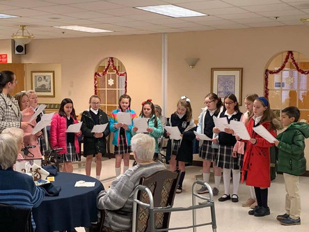 SCSP Students Use the Gift of Voice for Holy Family Residence