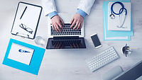 business-doctor-with-a-laptop-and-equipm