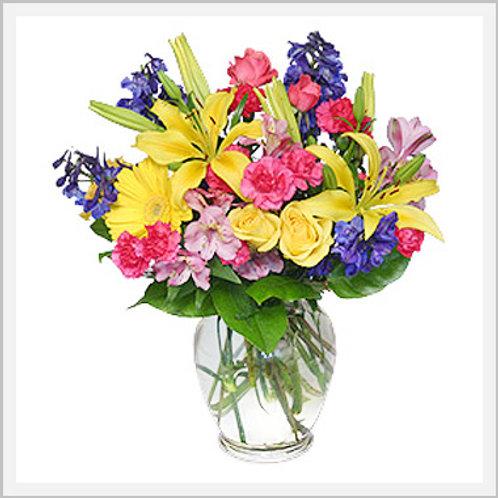 Seasonal Flowers In Glass Vase