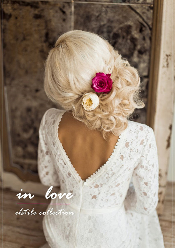 side-loose-wedding-updo-with-flowers
