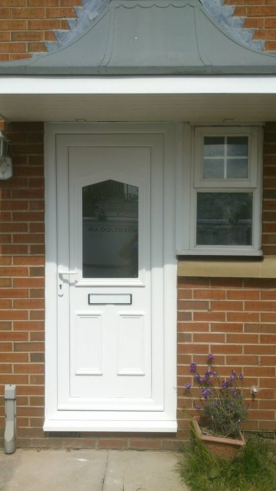 White Upvc Front Door installed by Driscolls