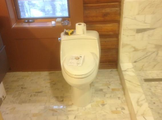 Tiled bathroom floor and coordinating shower
