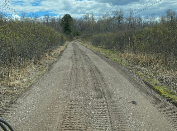 Soil conditioner added to gravel driveway